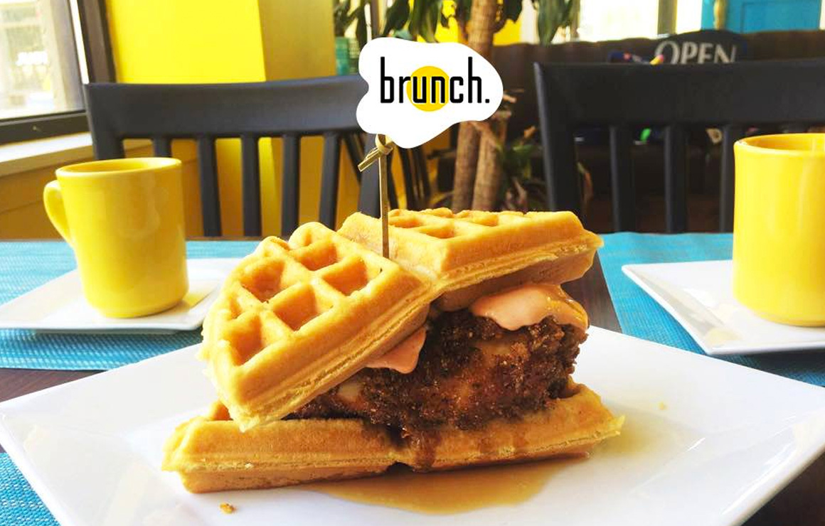 A breakfast sandwich made of waffles and fried chicken